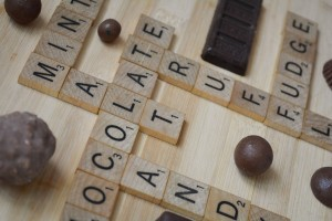 Scrabble Tiles Spelling Out Chocolate Related Words (Truffle, Fudge, Malt, etc.)